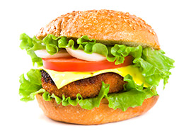 Hamburger with fish cutlet and vegetables
